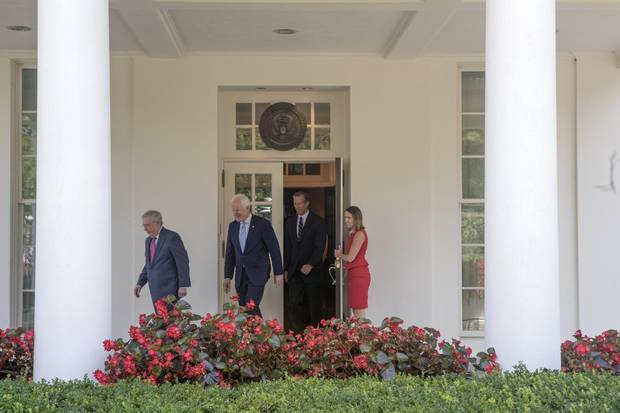 Mr. McConnell (R-Ky.), Sen. John Cornyn (R-Texas) and Sen. John Thune (R-S.D.) after meeting with President Donald Trump on health care legislation, at the White House in Washington, July 19, 2017. The nonpartisan Congressional Budget Office said on Thursday that the latest version of the Senate health bill would leave 15 million people without health insurance next year. ()