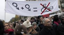 French government plans to legalize same-sex marriage and permit gay couples to adopt drew protesters to the streets of Paris and other cities in France over the weekend. (Thibault Camus/AP)