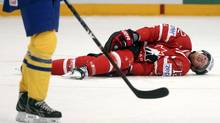 Canada's Eric Staal (R) lies injured on the ice during their 2013 IIHF Ice Hockey World Championship quarter-final match against Sweden at the Globe Arena in Stockholm May 16, 2013. (ARND WIEGMANN/REUTERS)
