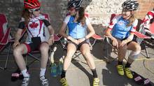Canadian Olympian Clara Hughes (left) chats with teammates Joëlle Numainville and Denise Ramsden (right) before going out on a training ride in Horsley, Sussex, England on Wednesday July 25, 2012. (THE CANADIAN PRESS)