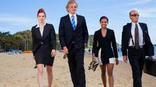 Business people on the beach (Jan Lombard/Getty Images/iStockphoto)