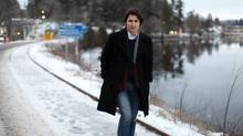Liberal MP and leadership hopeful Justin Trudeau walks along the Gatineau River in Wakefield, Quebec, on Tuesday, Dec. 12. (Dave Chan For The Globe and Mail)