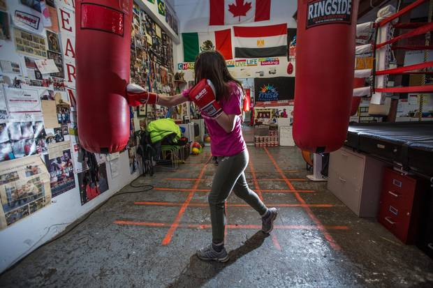 Mychaelynn Tenn, a member of the MJKO youth boxing charity, works out in the club's warehouse space.