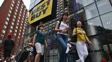 People walk past a Best Buy store in New York August 21, 2012. (BRENDAN MCDERMID/REUTERS)
