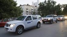 A motorcade of OSCE (Organization for Security and Cooperation in Europe) mission arrives at a hotel in Rostov-on-Don, Russia, Tuesday, July 29, 2014. (Sergei Pivovarov/AP)