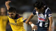 Ricardo Osorio (R) of Monterrey vies for the ball with Javier Morales (L) of Real Salt Lake City, during the first match of the final their Concachampions Cup, in Monterrey on April 20, 2011. (RONALDO SCHEMIDT)