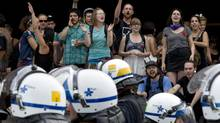 Students yell and gesture to members of the riot squad at the University of Montreal. (PAUL CHIASSON/THE CANADIAN PRESS)