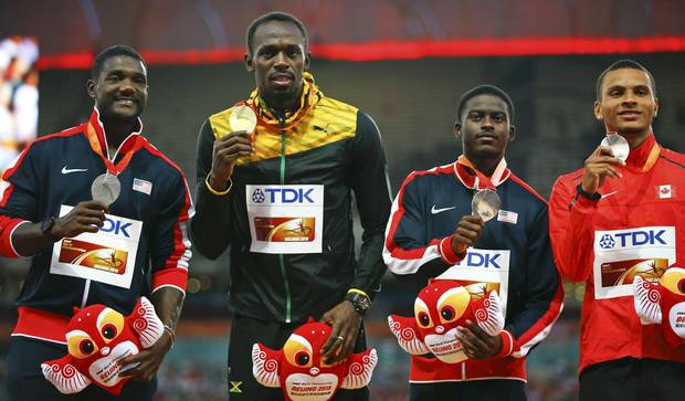 From left: Justin Gatlin of the U.S., Usain Bolt of Jamaica, Trayvon Bromell of the U.S. and Andre de Grasse of Canada present their medals after the men's 100m event during the 15th IAAF World Championships in Beijing, China on August 24, 2015.