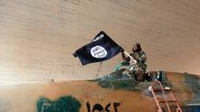 In this undated image posted Wednesday by the Raqqa Media Center of the Islamic State, a fighter celebrates the Islamic State's forces capturing the Tabqa Syrian air force base in Raqqa province. (the associated press)