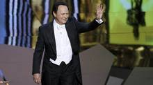 Oscar host Billy Crystal talks on stage at the 84th Academy Awards (GARY HERSHORN/REUTERS)