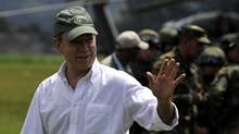 Colombian President Juan Manuel Santos waves to journalists after a press conference at a military base, in Popayan, Cauca department, Colombia, on Nov. 5, 2011. (Luis Robayo/AFP/Getty Images/Luis Robayo/AFP/Getty Images)