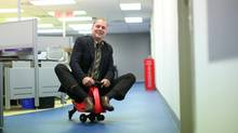 June 23, 2011: Tim Kimber, CEO of Plasmart, rides a PlasmaCar in the hall of his office in Ottawa. (Dave Chan For The Globe and Mail)
