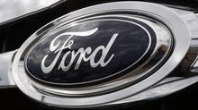 The Ford Motor Co. logo on the front of an automobile. (David Zalubowski/AP)