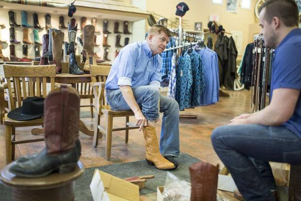 Brian Jean tries on some cowboy boots.