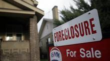 A foreclosure sign ona house in northwest Denver. (David Zalubowski/David Zalubowski/AP)