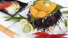 There are other less expensive items on the menu, but teishoku is the whole-meal deal most customers come for. Uni sashimi(right) and Grilled Mackerel Teishoku(left) at Tenhachi Japanese restaurant. (Rafal Gerszak for The Globe and Mail)
