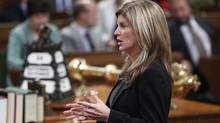 Canada's Public Works Minister Rona Ambrose speaks during Question Period in the House of Commons on Parliament Hill in Ottawa September 24, 2012. (CHRIS WATTIE/REUTERS)