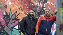 Youth worker Mostafa Ameziane, left, 31, and unemployed Hamza Ahmadoun, 25, pose in Antwerp. (ERIC VIDAL/REUTERS)