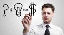 Young businessman innovating – drawing an idea for making money. (Getty Images/iStockphoto)