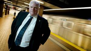 Toronto Mayor Rob Ford stands on the platform of the Kennedy subway station on Feb. 21, 2012.