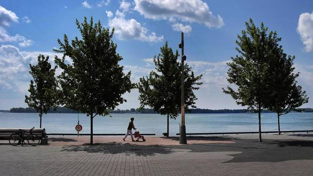 The NX20's 20.3 Mega-pixel sensor handles both highlights and shadows very well. As a daily user of professional gear I found the controls on this camera to be well placed and instinctive. (Pictured: Woman with stroller on lakeside promenade near Sugar Beach in Toronto.) (Moe Doiron/The Globe and Mail)