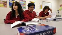 Evelyn Osorno, left, and siblings Gianmarco and Tixiana Ferrari, looks through language books at St. Marcellinus Secondary School in Mississauga, January 21, 2010. (J.P. Moczulski for The Globe and Mail/J.P. Moczulski for The Globe and Mail)