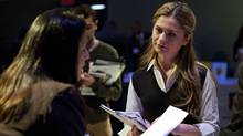 "A woman speaks to a potential employer at the ""Hiring Our Heroes"" job fair at the Intrepid Sea, Air and Space Museum in New York March 28, 2012. (ANDREW BURTON/ANDREW BURTON/REUTERS)"