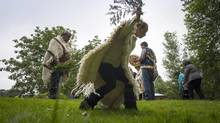 Members of the Coast Salish First Nations, the Portuguese community and Silvey family join master carver Luke Marston as they bless the ground for the future home of a 6.4-metre high sculpture in Vancouver's Stanley Park on Tuesday. (John Lehmann/The Globe and Mail)