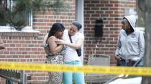 Two women comfort each other after an incident in which two people were shot dead and at least 19 others injured in a shooting at a neighbourhood in Scarborough earlier this summer. Chief Bill Blair said the shots broke out at a large party at 193 Danzig Street. (Peter Power/The Globe and Mail)