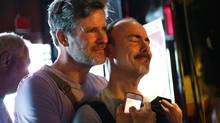 Patrons at the Stonewall Inn in New York watch coverage of the U.S. Supreme Court ruling on the Defense of Marriage Act Wednesday. (BRENDAN MCDERMID/Reuters)