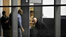 Bodyguards try to block the view of Canadian singer Justin Bieber as he goes through Wladyslaw Reymont Airport in Lodz following his concert March 25, 2013. (AGENCJA GAZETA/REUTERS)