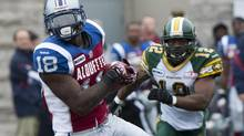 Montreal Alouettes' Jamel Richardson breaks away from and Edmonton Eskimos' T.J. Hill during first half CFL action in Montreal, Sunday, October 28, 2012. (Graham Hughes/THE CANADIAN PRESS)
