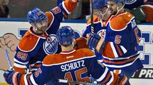 Edmonton Oilers' Sam Gagner (89), Nick Schultz (15), Ales Hemsky (83) and Mark Fraser (5) celebrate a goal against the Ottawa Senators during second period NHL hockey action in Edmonton, Alta., on Tuesday March 4, 2014. (JASON FRANSON/THE CANADIAN PRESS)