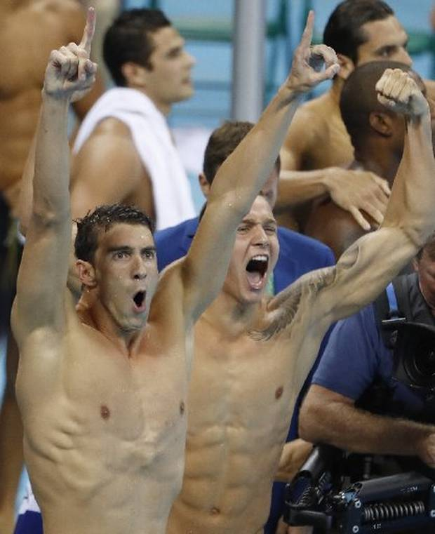USA's Michael Phelps (L) and USA's Caeleb Dressel react after team USA won the Men's 4x100m Freestyle Relay Final during the swimming event at the Rio 2016 Olympic Games.