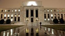 Word that the U.S. Federal Reserve may start tapering its monetary easing policy soon has caused some stocks to hit rough patches. (J. Scott Applewhite/AP)