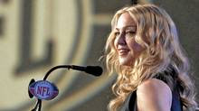 Madonna talks about her upcoming Super Bowl halftime show in Indianapolis, Feb. 2, 2012. (Jeff Haynes / Reuters)