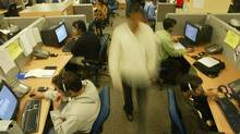 Indian engineers are seen at a call center near New Delhi, December 3, 2003. (KAMAL KISHORE/REUTERS)