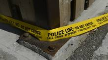 Police tape surrounds a crime scene (Fred Lum/The Globe and Mail)