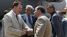 Foreign Affairs Minister John Baird arrives in Benghazi, Libya, on June 27, 2011. (Hassan Ammar/AP)