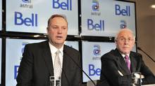 Bell president and CEO George Cope, left, and Astral Media president and CEO Ian Greenberg speak during a press conference in Montreal, March 16, 2012. (Paul Chiasson/Paul Chiasson/The Canadian Press)