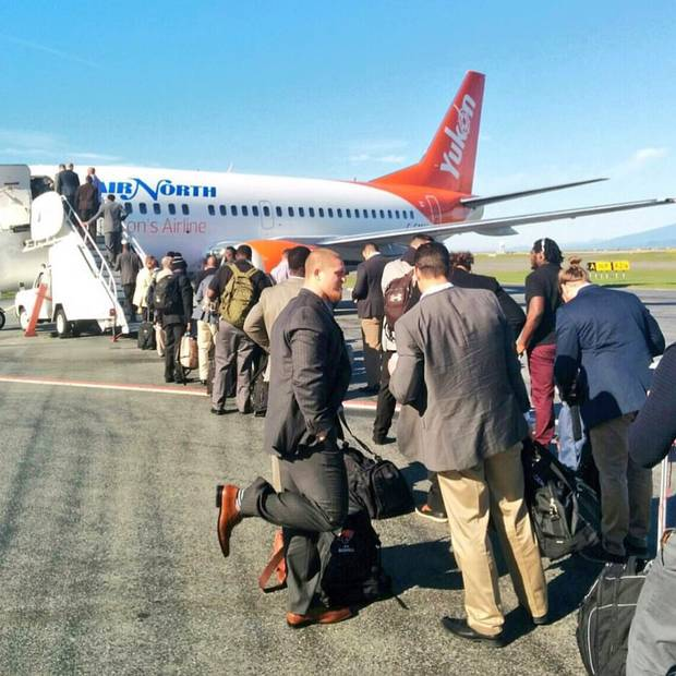 The B.C. Lions board a plane.