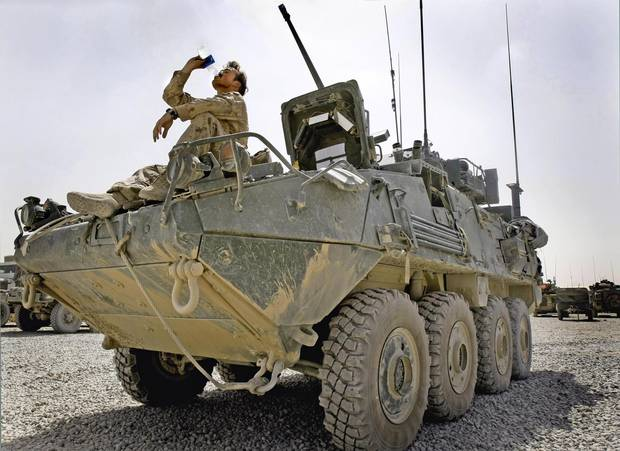Canadian soldier Steve Sabo with the 2nd Battalion, Princess Patricia's Canadian Light Infantry from Shilo, Manitoba, drinks some water on a LAV-3 on Friday Aug. 1, 2008.