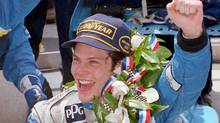 (Jacques Villeneuve holds the winner's bottle of milk in Victory Lane after winning the Indianapolis 500 Sunday, May 28, 1995, in Indianapolis. Villeneuve won the Lou Marsh Trophy, a Toronto Star award recognizing the most outstanding athlete of the year. (AL BEHRMAN/AP PHOTO/Al Behrman)