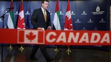 Foreign Affairs Minister John Baird leaves a news conference about visas between Canada and the United Arab Emirates, in Ottawa on Tuesday. (FRED CHARTRAND/CANADIAN PRESS)