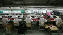 Workers are seen inside a Foxconn factory in the township of Longhua in the southern Guangdong province May 26, 2010. (BOBBY YIP/REUTERS)
