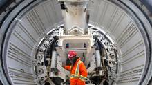 TBM mechanic Riaz Ishmail in front of the Tunnel Boring Machine on April 9, 2013. (Chris Young for The Globe and MaiL)