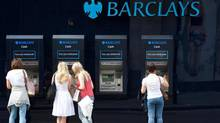People use a line of Barclays cash dispensers in central London, June 28, 2012. Britain said on Thursday it had brought in the fraud squad to investigate possible crimes and would tighten laws over attempts to manipulate lending rates, a scandal which has engulfed Barclays and is expected to spread to other banks. (PAUL HACKETT/REUTERS)