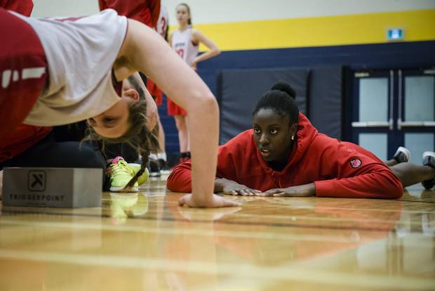 Amihere cheers on athletes during testing at the Canada Basketball camp at Humber College in Toronto Dec. 15, 2017.
