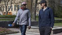 Team Canada and Philadelphia Flyers teammates Wayne Simmonds, left, and Luke Schenn walk in the park in front of their hotel and the main library in Stockholm, Monday, May 6, 2013 during the world hockey championship in Stockholm Sweden. Team Canada decided to skip practice and take the day off before they game against Norway on Tuesday, May 7. (Jacques Boissinot/THE CANADIAN PRESS)