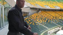 Edmonton Eskimos general manager Ed Hervey looks over Commonwealth Stadium in Edmonton on August 1, 2013. (Dean Bennett/THE CANADIAN PRESS)
